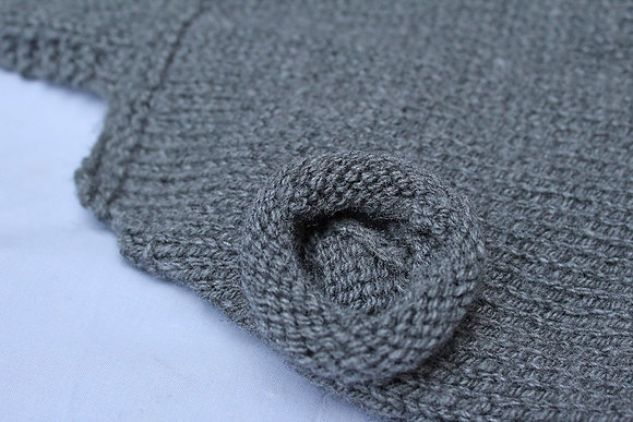 Knitted jumper with hood