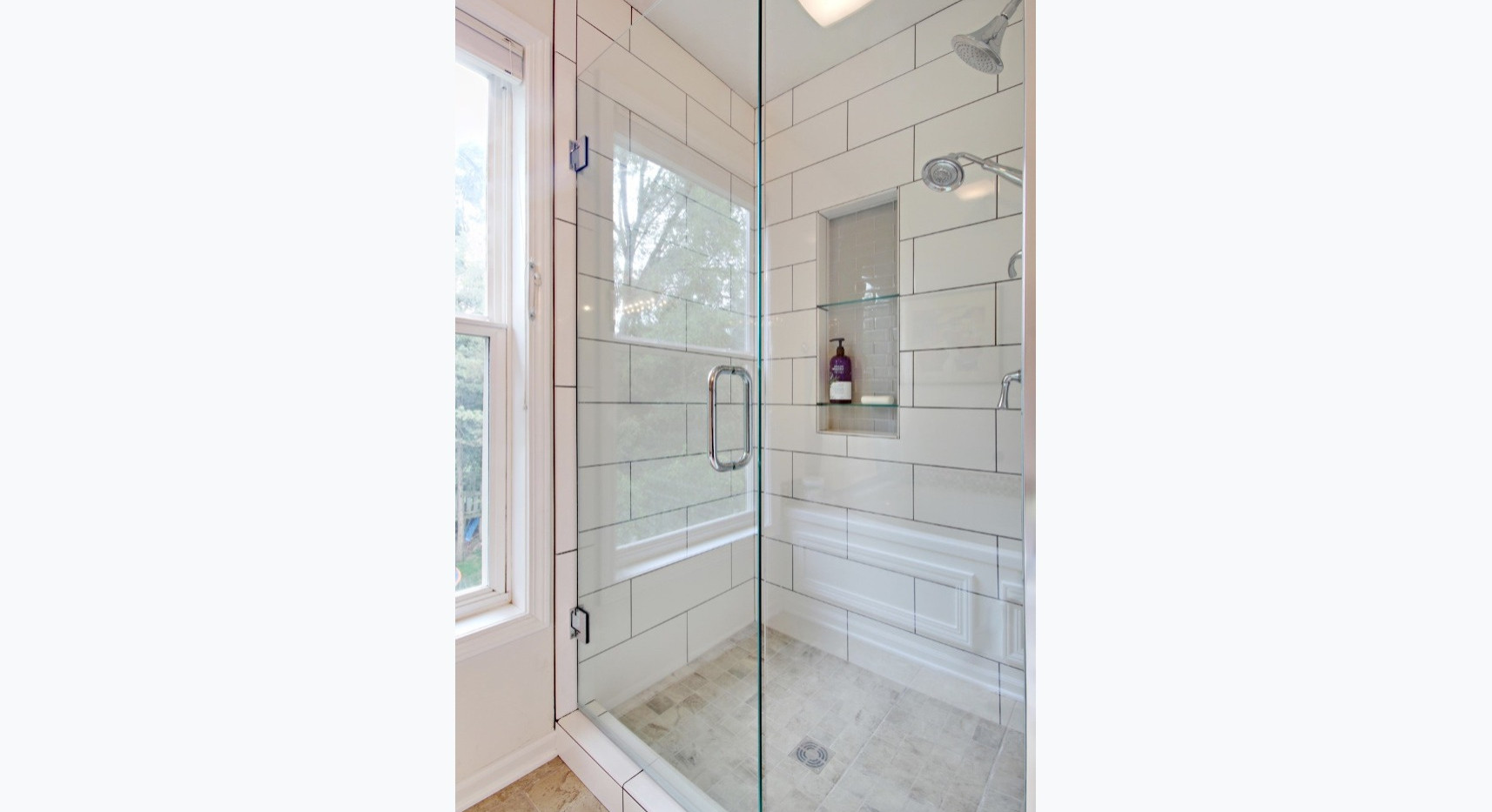 Stunning new standing shower design in partial bathroom remodel by Renew Home Improvement remodeling contractor