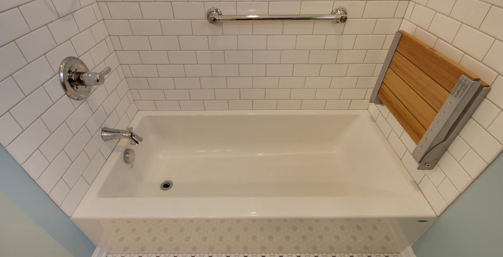 Hudsonville bathroom remodel for the elderly with grab bars and shower bench seat