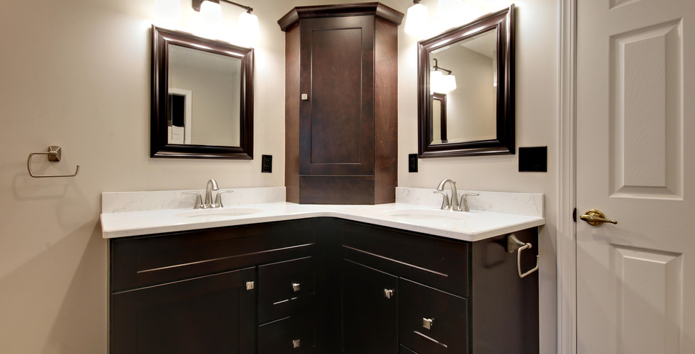 Double vanity of Jenison bathroom remodel featuring black and white color design