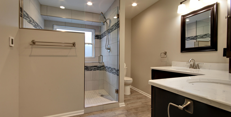 Jenison traditional full bathroom remodel featuring a black, brown, grey, and white design
