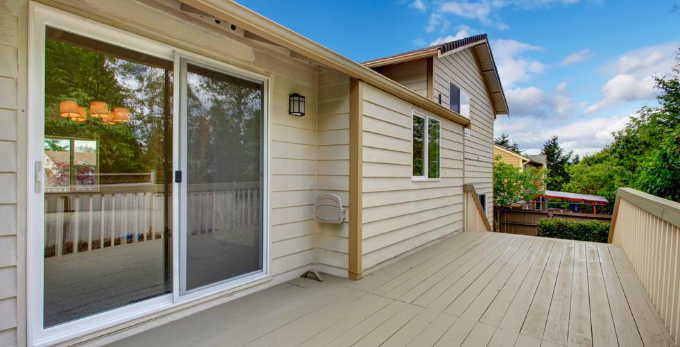 Beautiful patio slider door replacement in Grand Rapids. Remodeled by Renew Home Improvement contractor