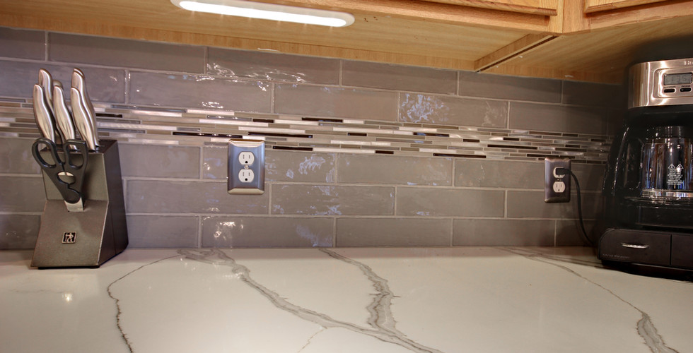 New kitchen granite counter space with tile backsplash. Kitchen remodel done Renew Home Improvement