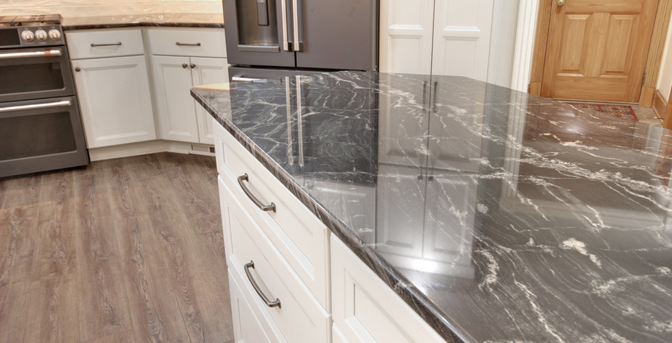 New modern kitchen island with white drawers in Jenison by Renew Home Improvement remodeling contractor