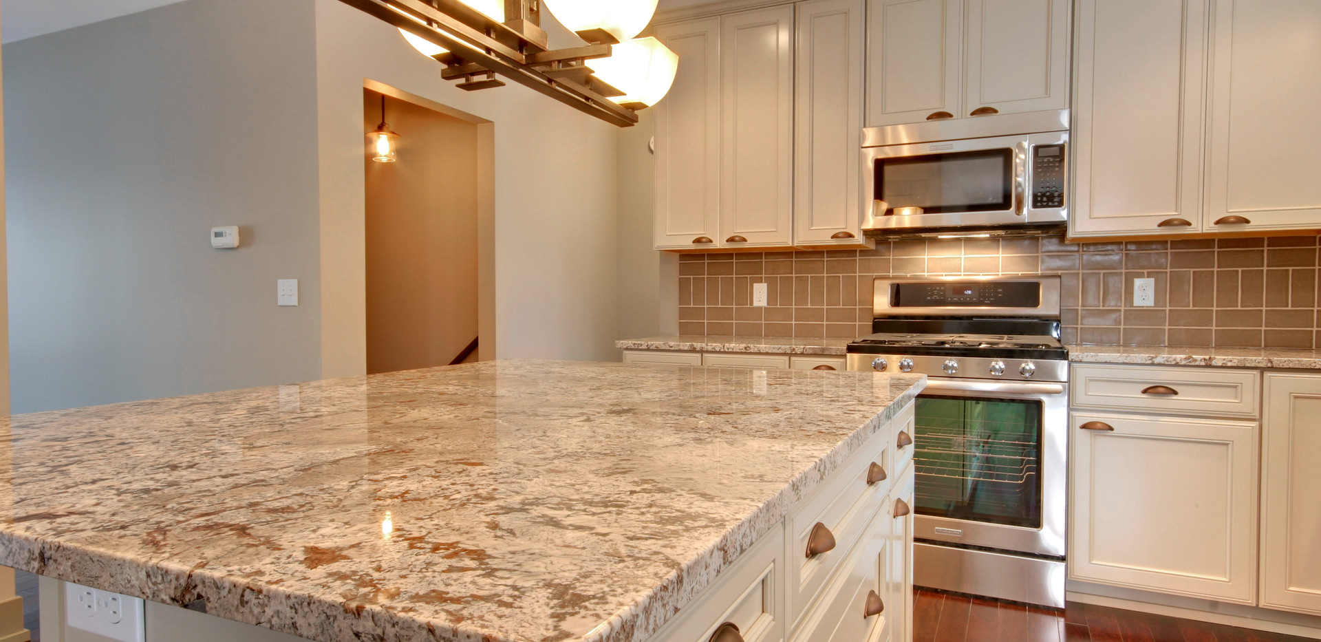 Granite counter top design of kitchen remodel by Renew Home Improvement remodeling contractor