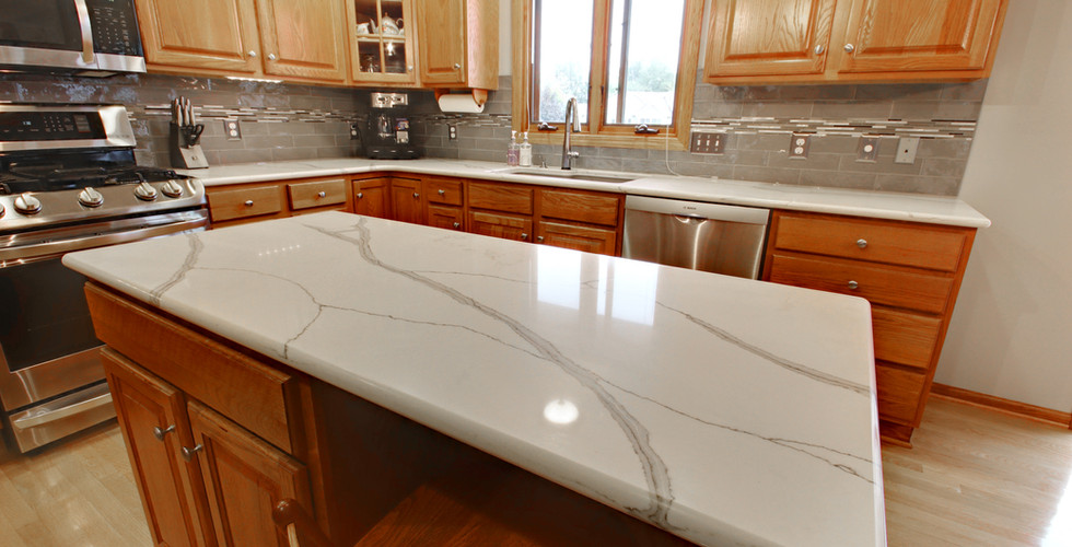 Beautiful new kitchen island featuring granite counter tops in Hudsonville by Renew Home Improvement remodeling contractor