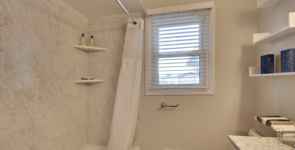 New tub shower in Grandville bathroom remodel by Renew Home Improvement