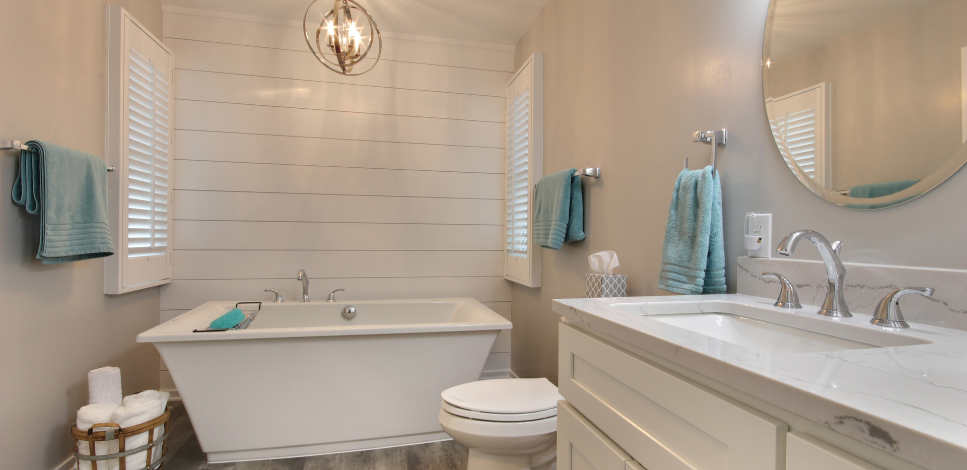 Beautiful full bathroom remodel in Holland featuring new floors, paint, vanity, tub, and more