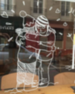 Drawing of social link on a shopkeeper's showcase