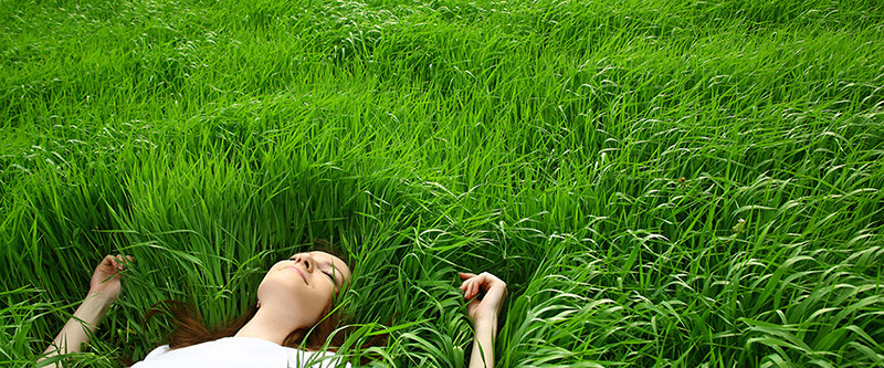 Girl Lying in Grass