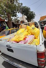 Senegal_Pickup_mit_Säcken.jpg
