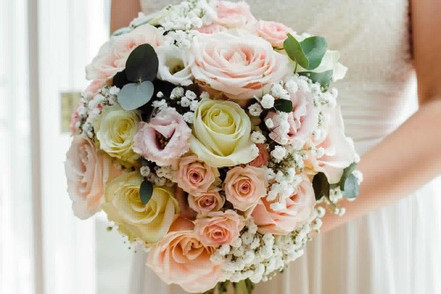 Rose and gypsophilia domed bouquet.