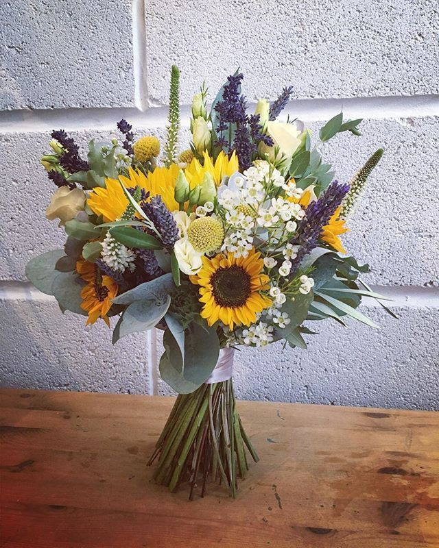 Sunflower filled bridal bouquet heading to Charlton House