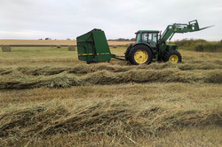 Round bale and tractor