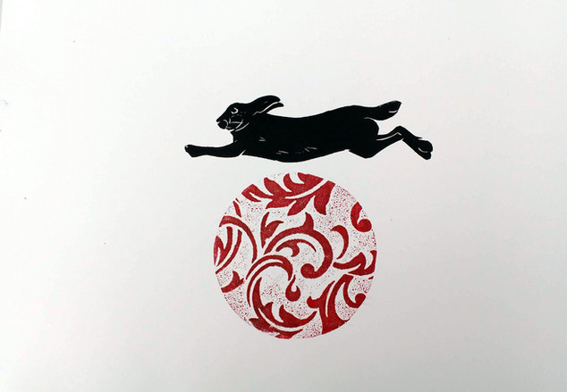 hare jumping a ball