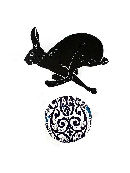 Hare leaping over a ball