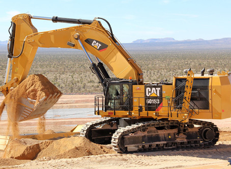 CAT 6015B working in some fine tailings before hitting the rock pile
