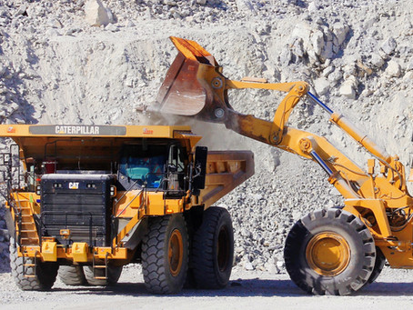 One of our Tier 4 CAT 777G haul trucks grabbing another load of rock to be hauled up to the crusher