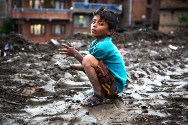THE BLUE BOY PLAYING WITH MUD AND RUBBLE Bhaktapur