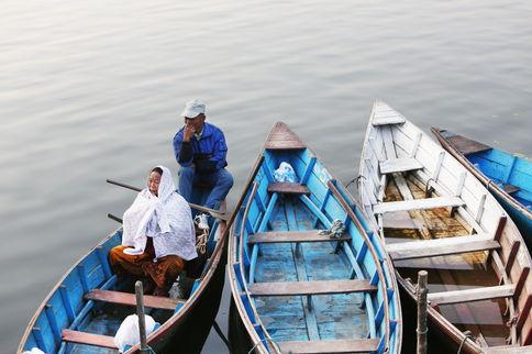 THE CALM ON A BLUE BOAT Lake Pokhara