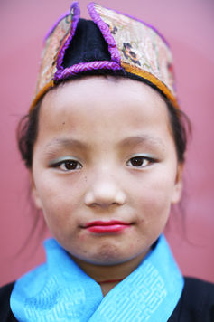 CURIOUS GLANCE OF A NEPALESE-TIBETAN YOUNG DANCER