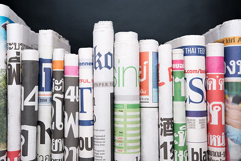 Newspapers folded and stacked.jpg