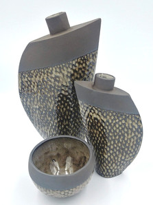 Fishscale design vases and bowls
