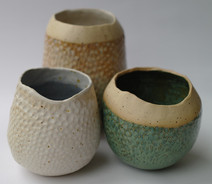 Various fish scale coiled pots