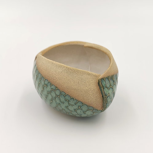 Asymmetric coiled bowl