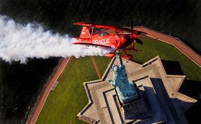 Sean D. Tucker Flies Over Lady Liberty