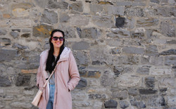 Kay and stone wall outside