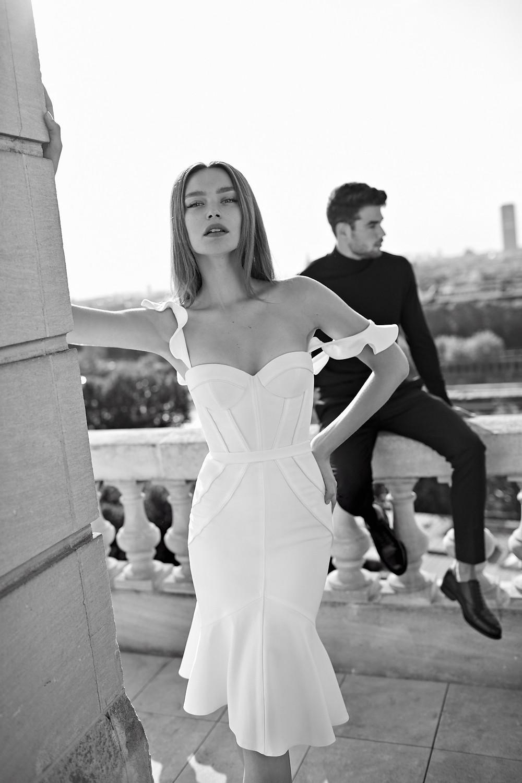 Bride wears structured midi style white wedding dress from Israeli designer Eisen Stein.