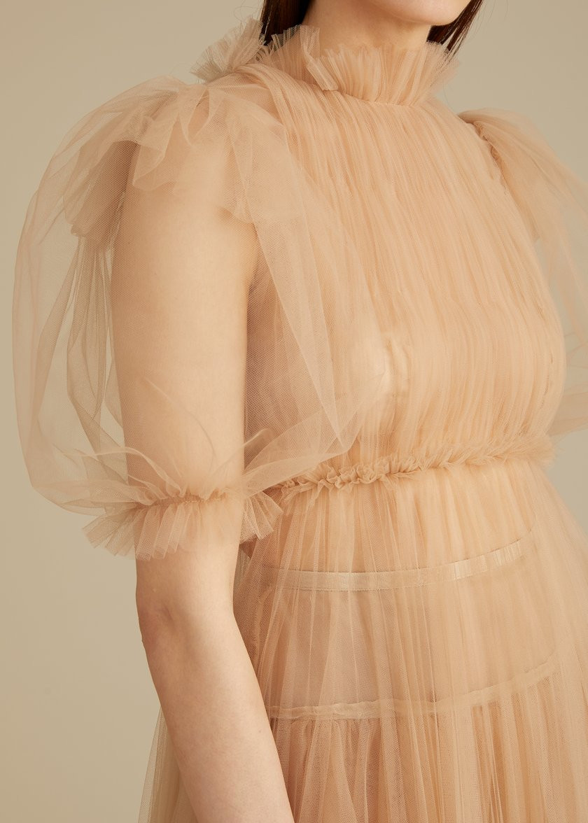 Bride wears nude blush tulle wedding dress with puff sleeves by NY designer Khaite.