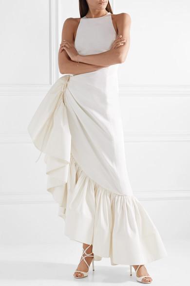 Bride wears asymmetric, white ruffled dress by designer Rosie Assoulin.