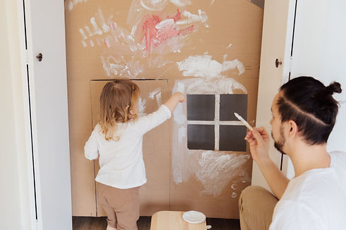 photo-of-child-painting-cardboard-393325