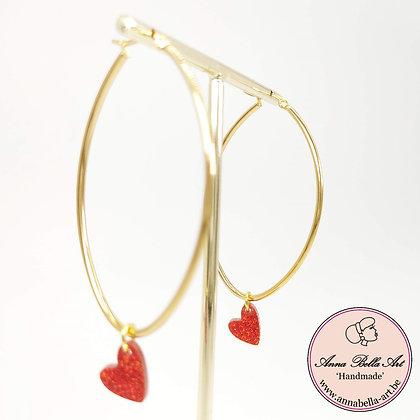 Anna Line oorbellen - Rood glitterhart - ovalen goudkleurige ring