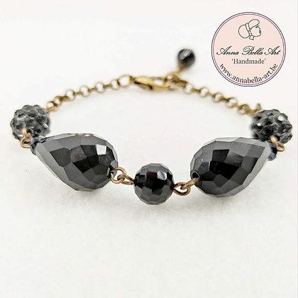 Anna Line druppel armband - Zwart kristal en Swarovskiparel & brons