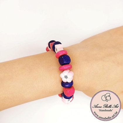Little Anna fimo bloem-houten kubus armband - roze-paars-fucshia - op elastiek