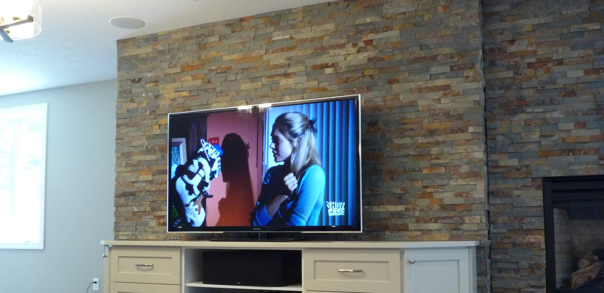 TV and Stand with In Ceiling Speakers