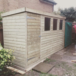 Shed and log store installed today #shed #garden #gardening #gardenshed #gardenbuiding #home #knight