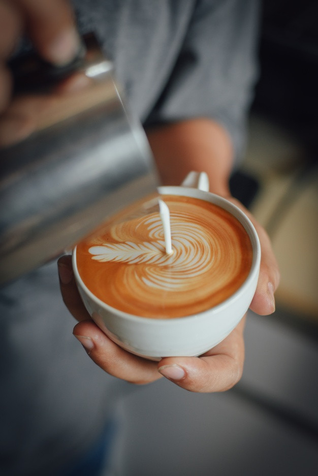 Woman pouring coffee cream