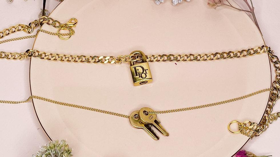 Double pendentif Dior cadenas