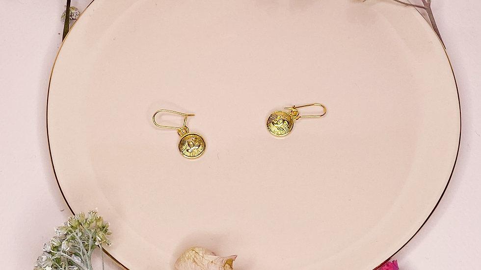 Boucles d'oreilles upcyclées Chanel