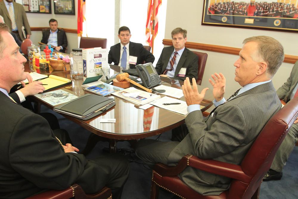 NAIOP member Barry Leasure and REBIC Executive Director Joe Padilla meet with Speaker Thom Tillis in Raleigh