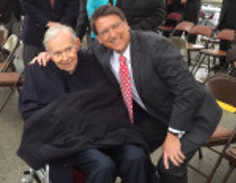 Allen Tate and Governor Pat McCrory at the dedication of the last segment of I-485 in his honor this past March.