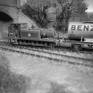 ex-LB&SCR A1X Class No 32655 edges towards Class A tank wagon No 852 at Great Coles Wood.  With No 32655 carrying the livery worn during spells on the Hayling Island branch and Kent & East Sussex Railway during the 1950s, the scene could be mistaken for that of seventy years previous
