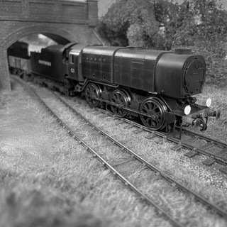 ex-SR Q1 Class No C1 exerts little effort as she heads south through the Sussex countryside with a goods train