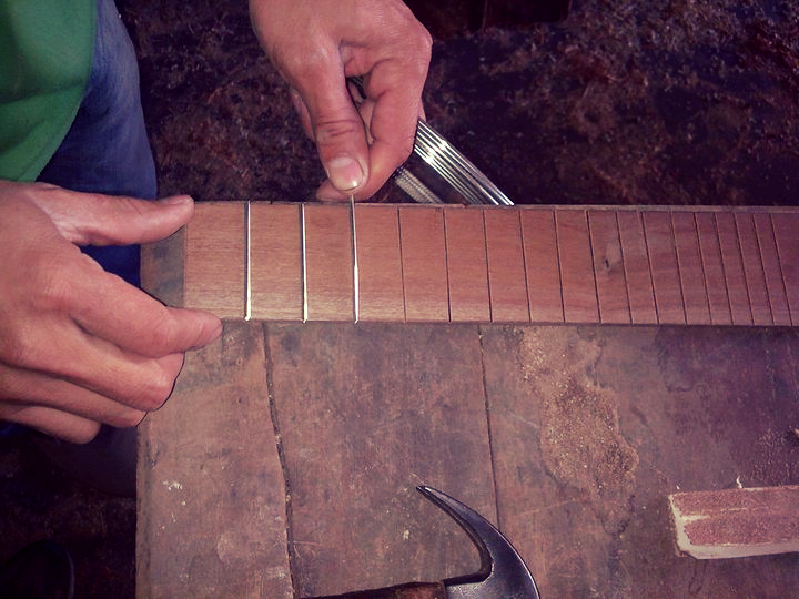 Putting the frets on a charango