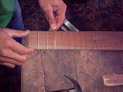 Putting the frets on a charango