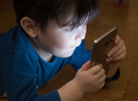 Are children really protected by current cell phone radiation standards?